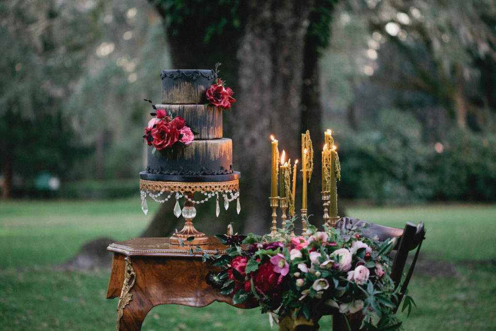 dramatic cake and floral at eden garden 30a wedding editorial